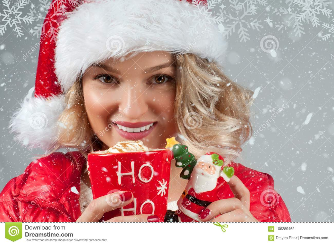 Beautiful Woman In Santas Hat Holding Cup Of Coffee Christmas Mood Winter And Snowflakes