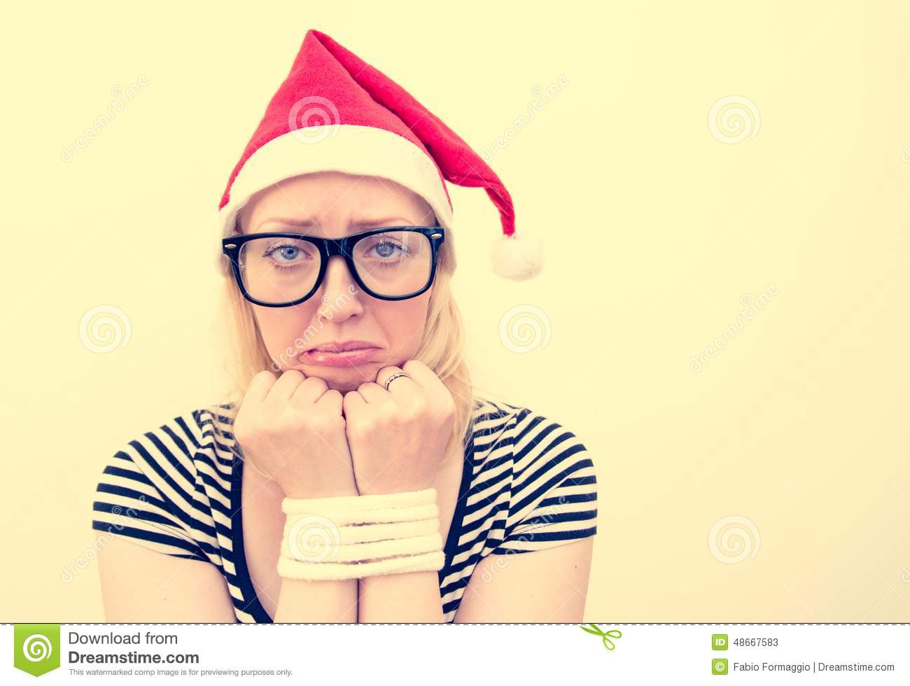Woman with santa s hat sad girl with tied up hands