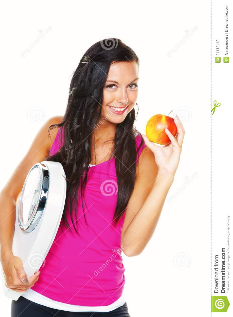 ... woman with a balance in his hand smiling after a successful diet