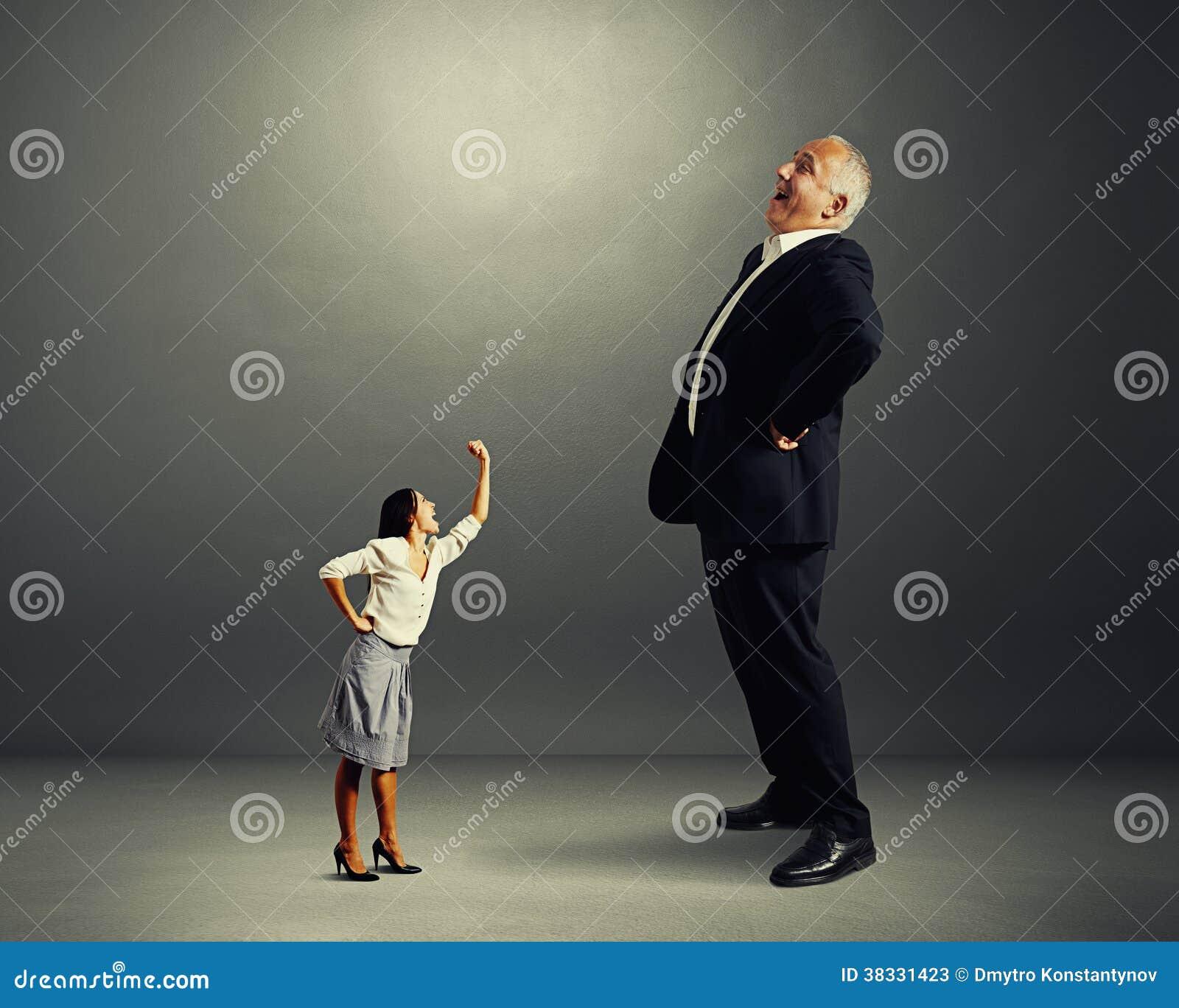Woman Screaming At Big Laughing Businessman Stock Image Image Of