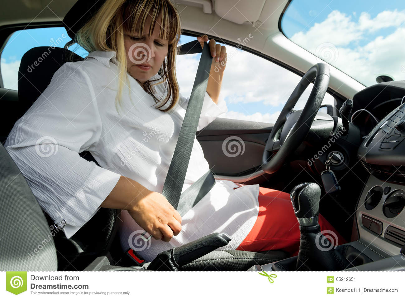 Woman with a seat belt in the car