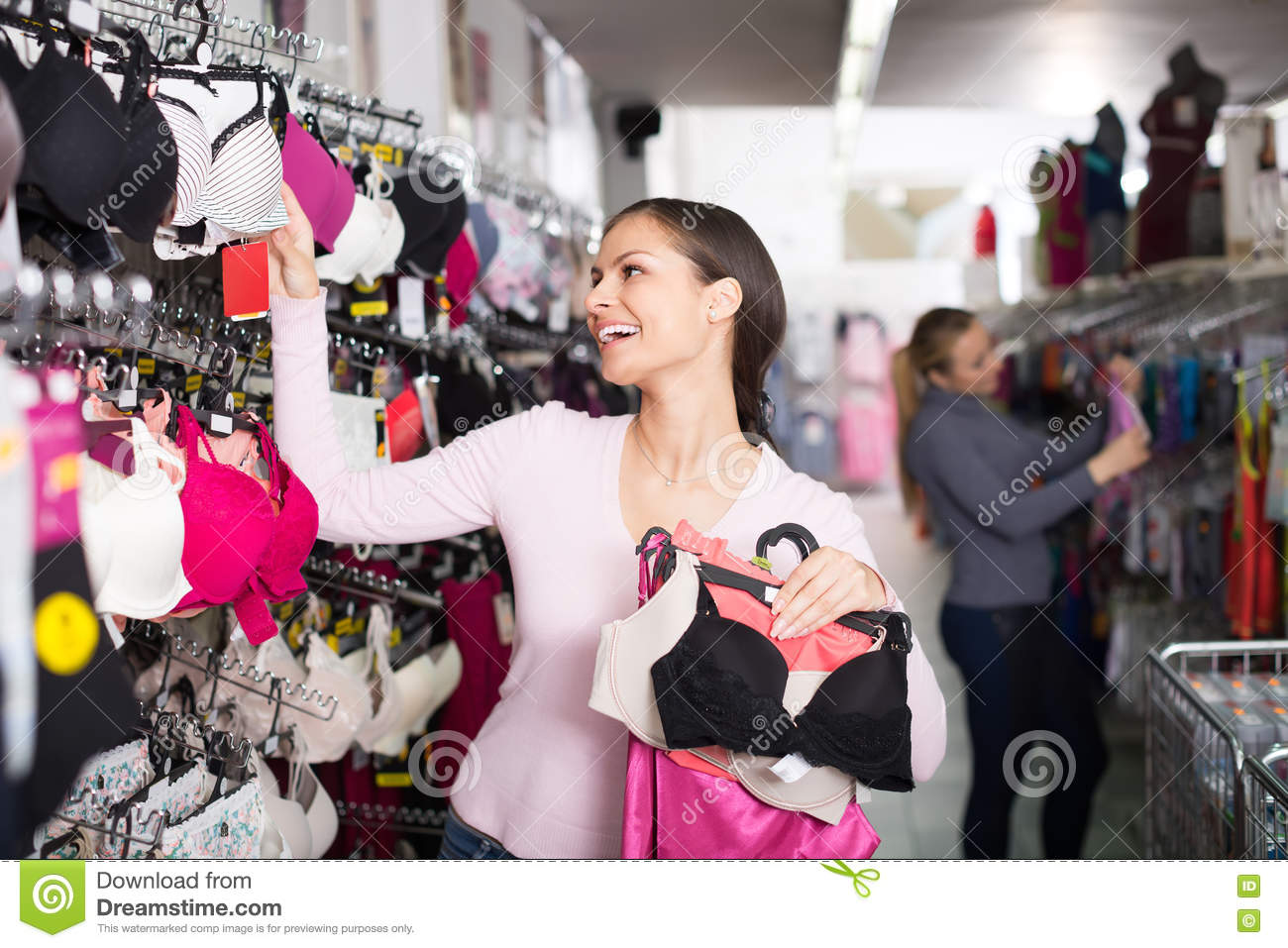 Woman Selecting Bra In Lingerie Store Stock Photo - Image: 72663651
