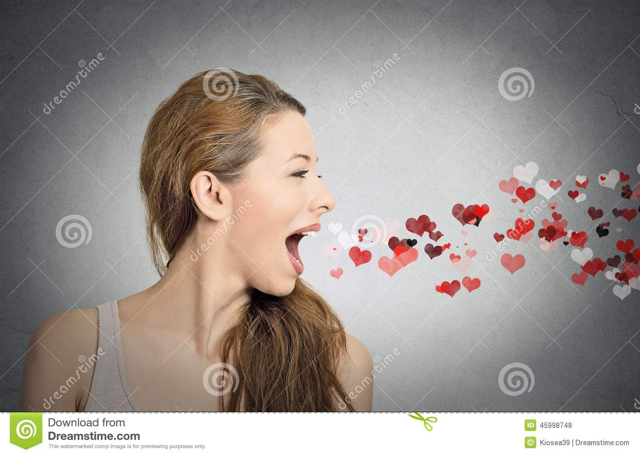 Woman sending kisses, red hearts coming out of open mouth