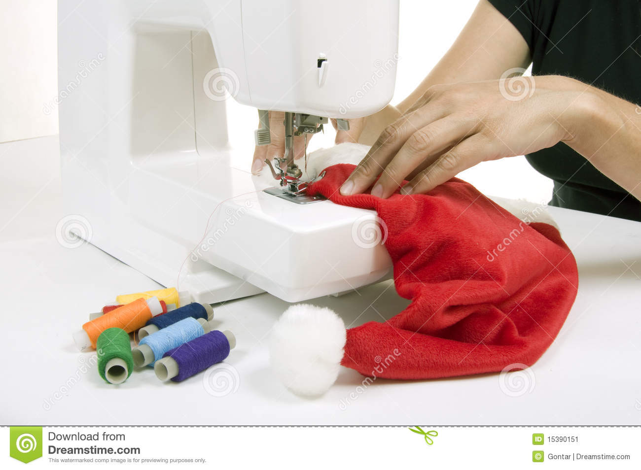Woman sewing a hat for santa claus stock image image 15390151