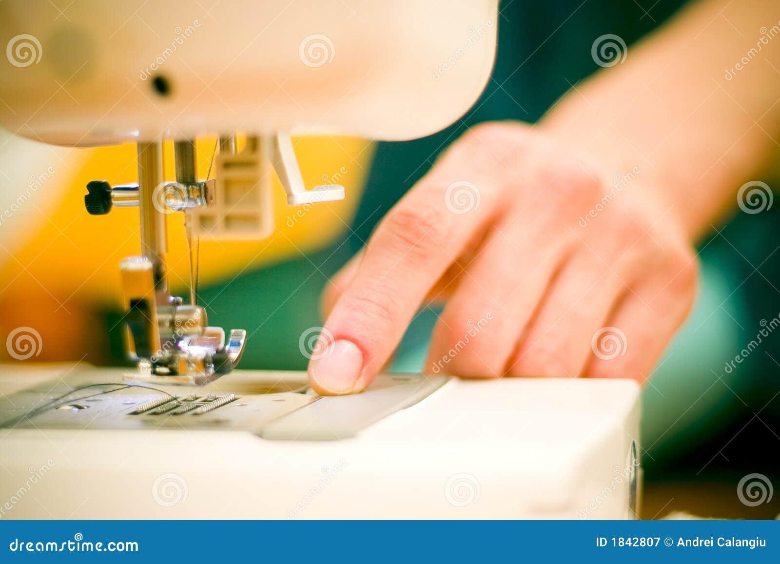 Woman at sewing machine.