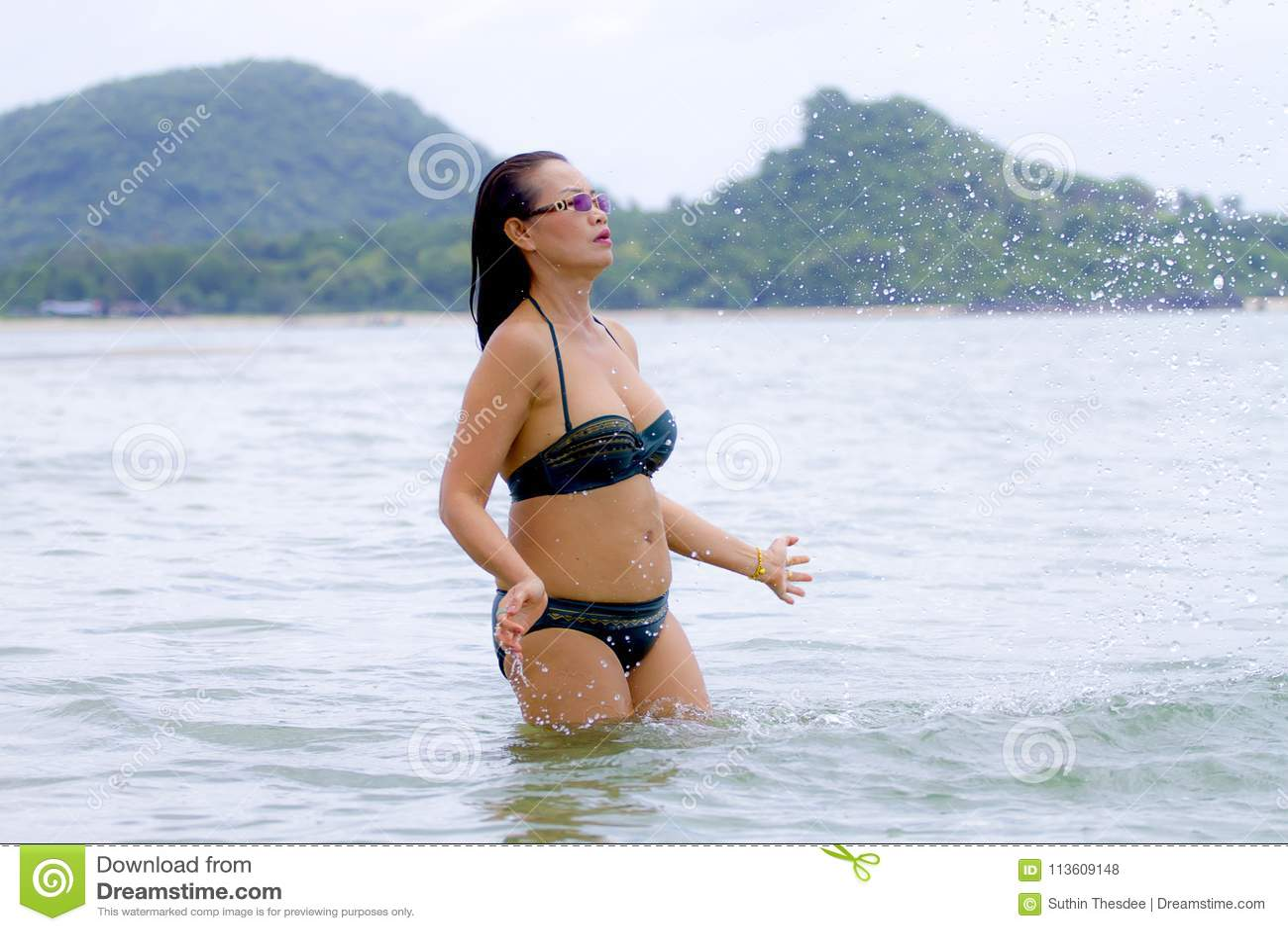 315f1bff278 Woman with bikini play water in the beach Tap Skea, Prachuap Khirikhan  Province Thailand