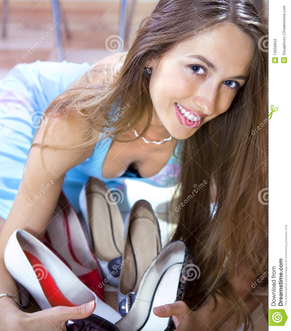 Woman with shoes in shopping mall