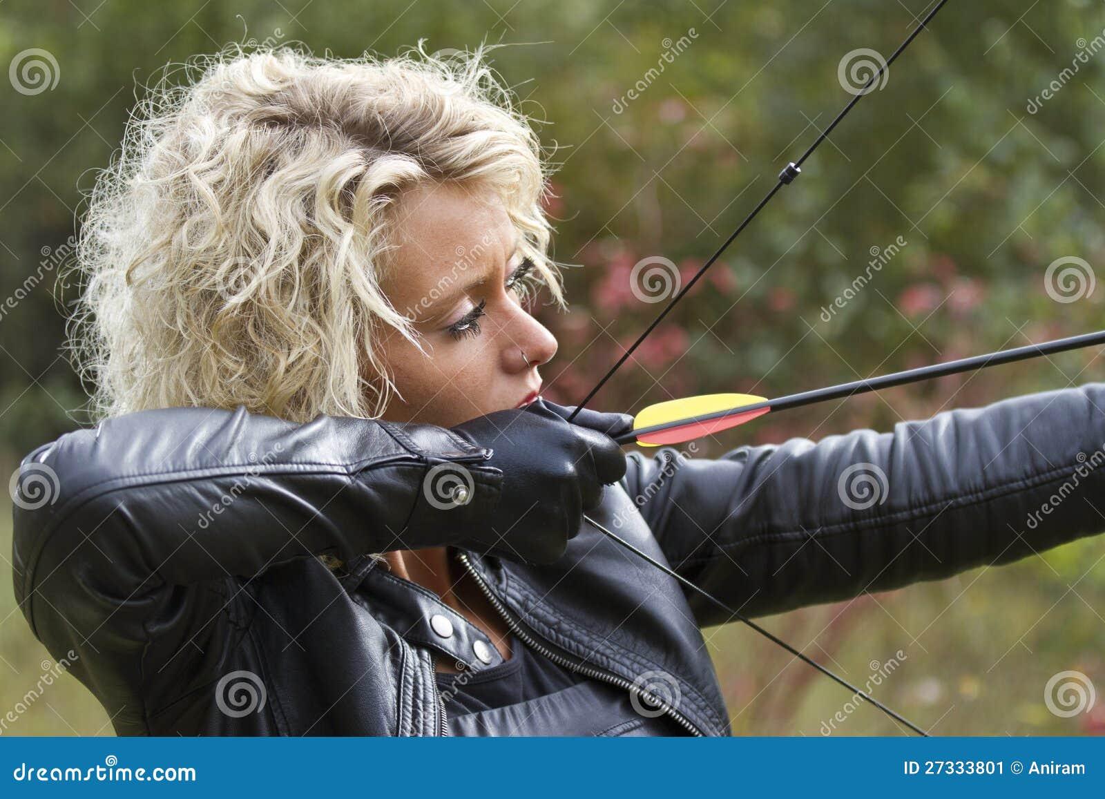 b92079997ce5c Woman Shooting With Bow And Arrow Stock Image - Image of violence ...