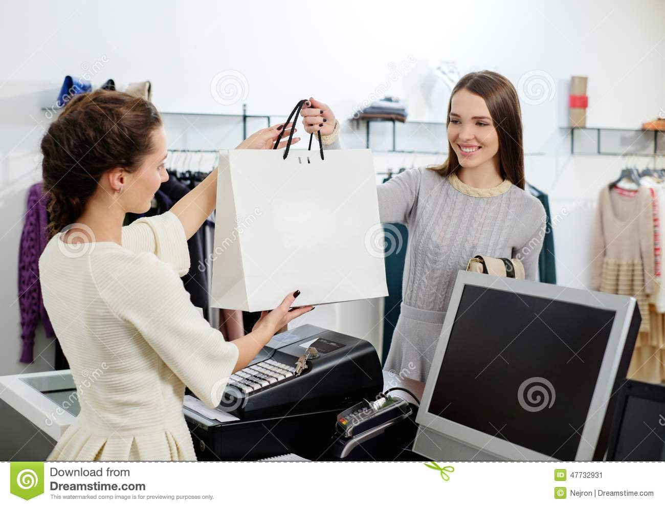 Woman And Shop Assistant In A Showroom Stock Photo - Image: 47732931