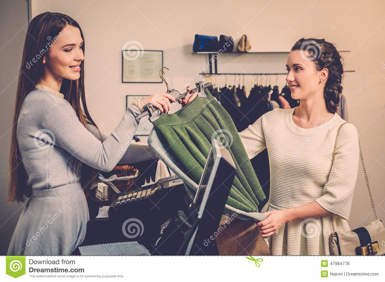 woman and shop assistant in a showroom stock photo. Black Bedroom Furniture Sets. Home Design Ideas