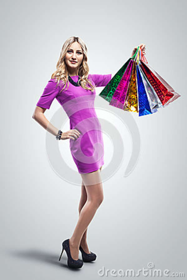 Woman with Shopping Bags. Shopper. Sales. Studio shooting