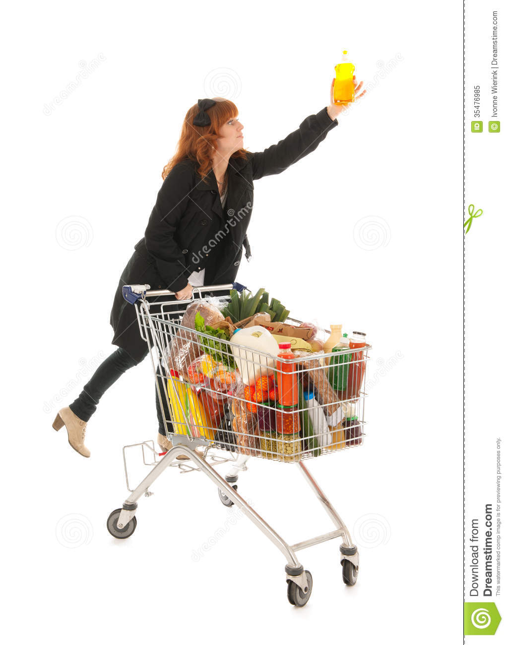 Woman with shopping cart full with dairy grocery products climbing and ...