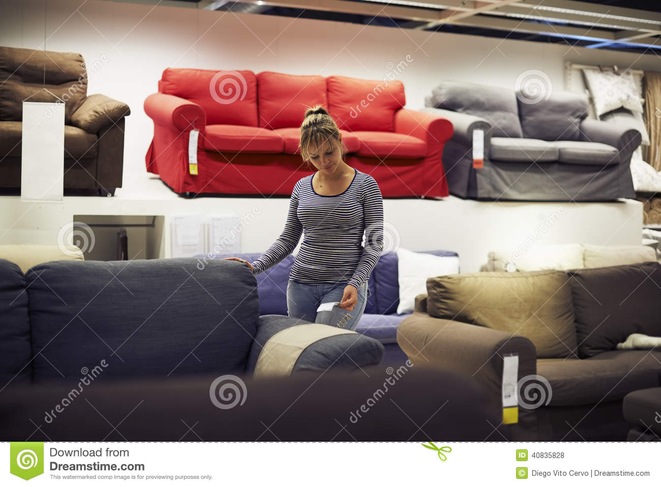 Woman Shopping For Furniture And Home Decor Stock Photo