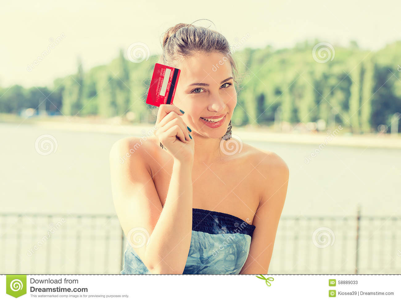 Woman shopping on line showing credit card
