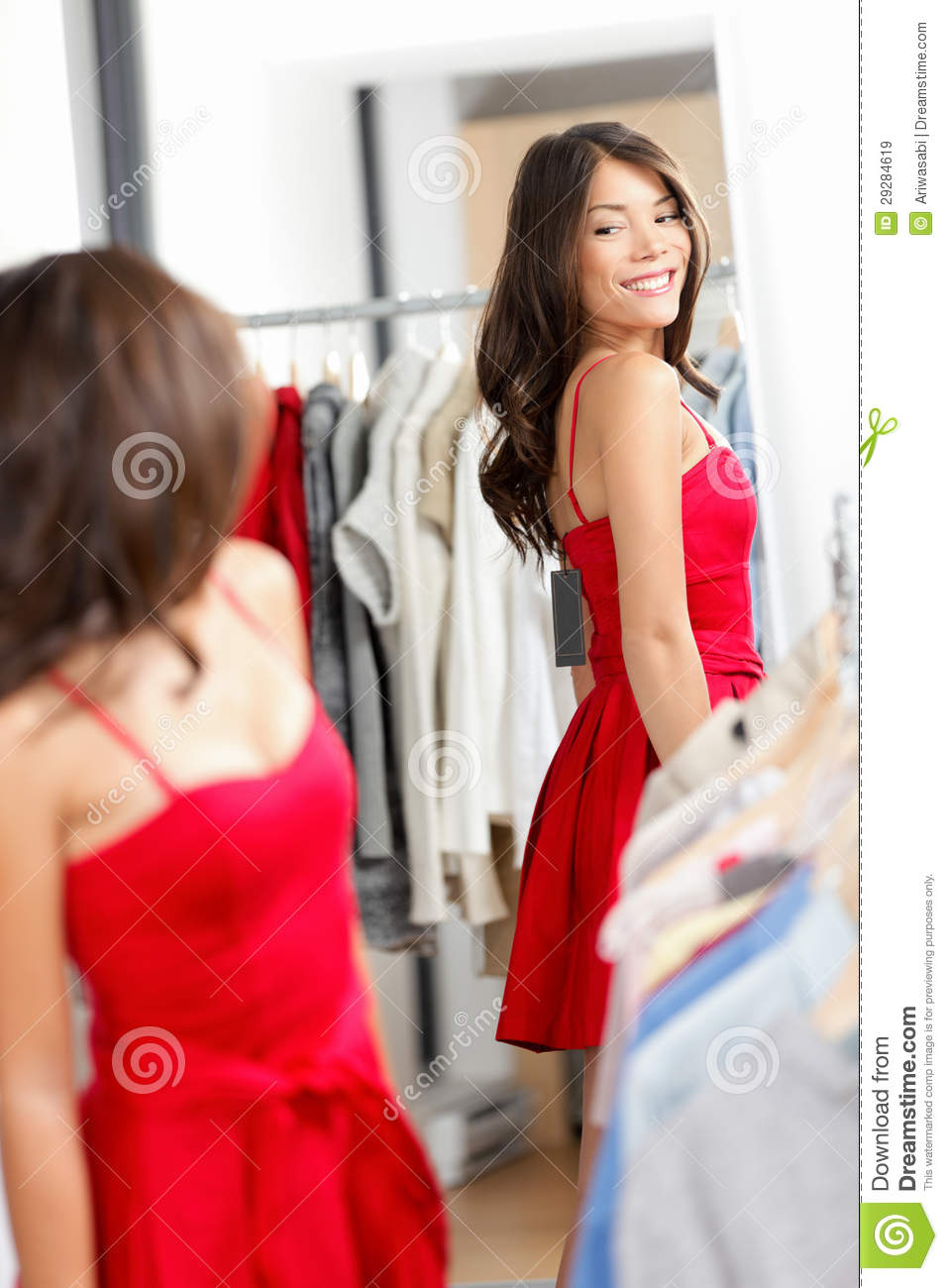 Royalty free stock images woman shopping looking in mirror trying