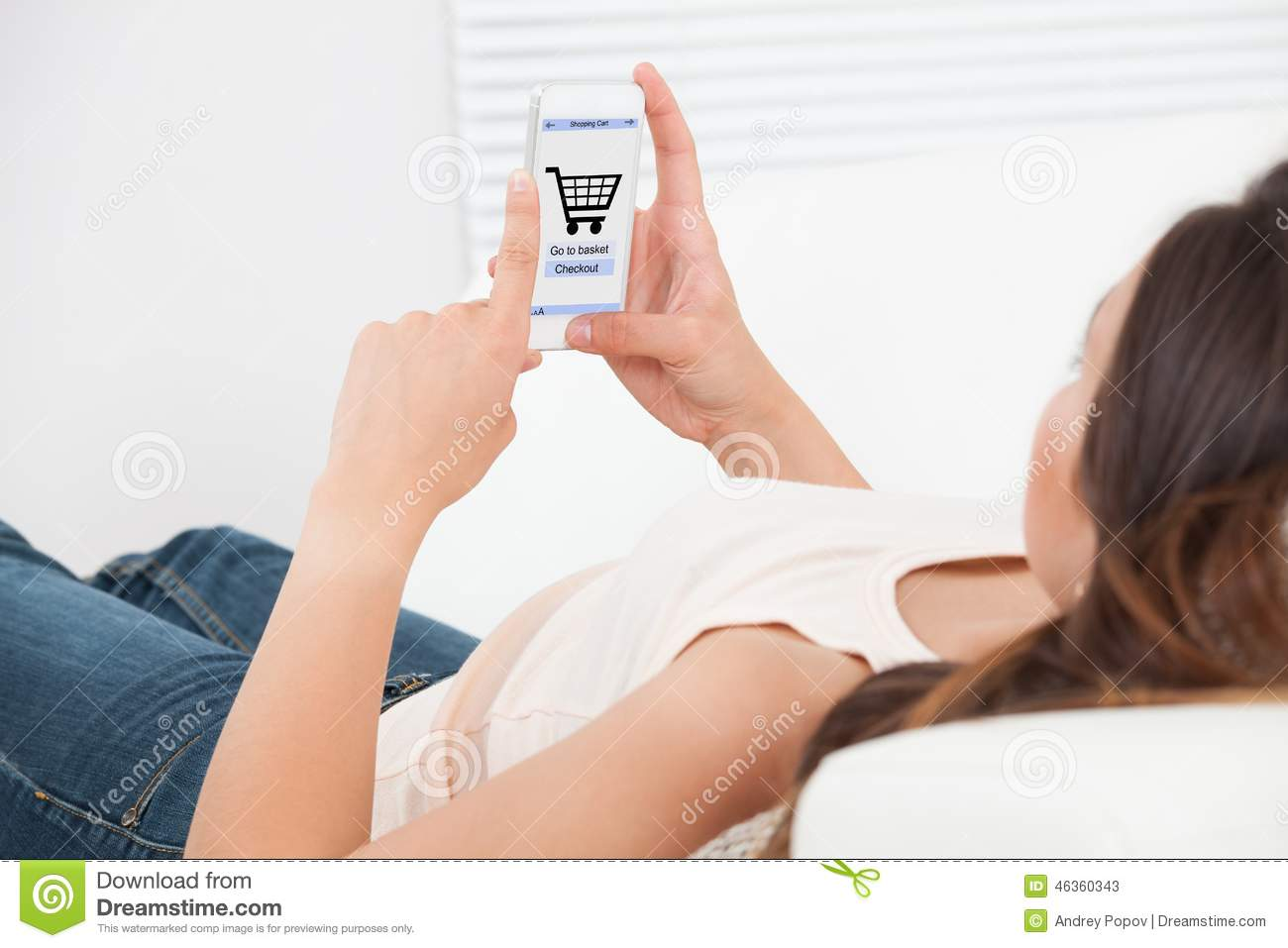 Woman shopping online on mobile phone at home stock photo for Shop on line mobili