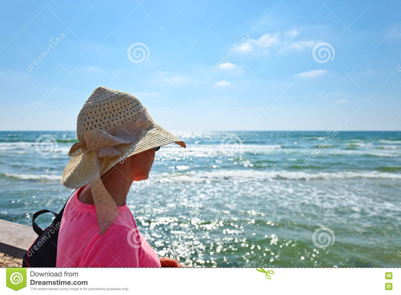 Woman on a shore of Mediterranean sea