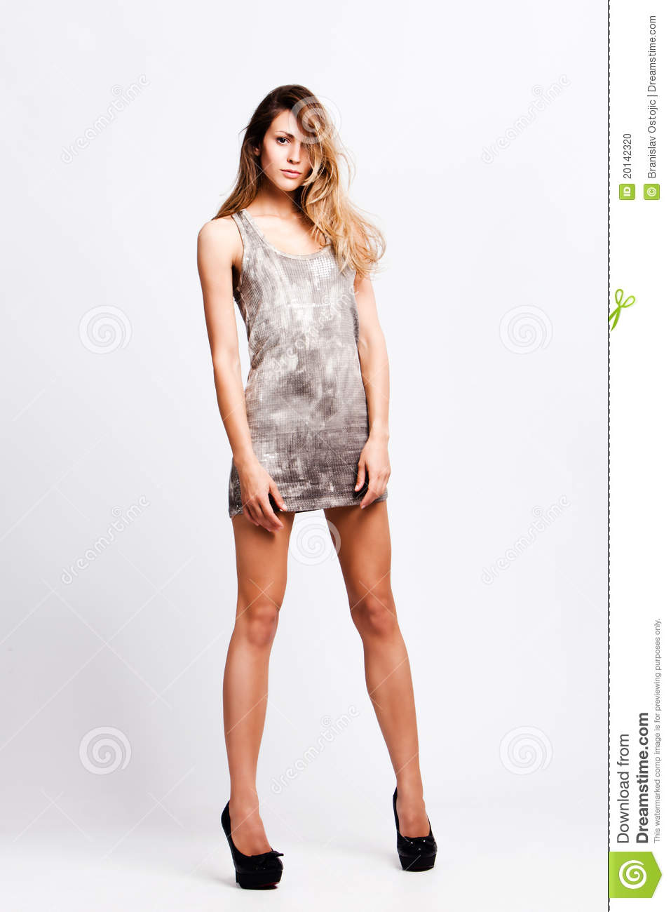 Woman In Short Dress And High Heel Shoes Stock Photo - Image: 20142320