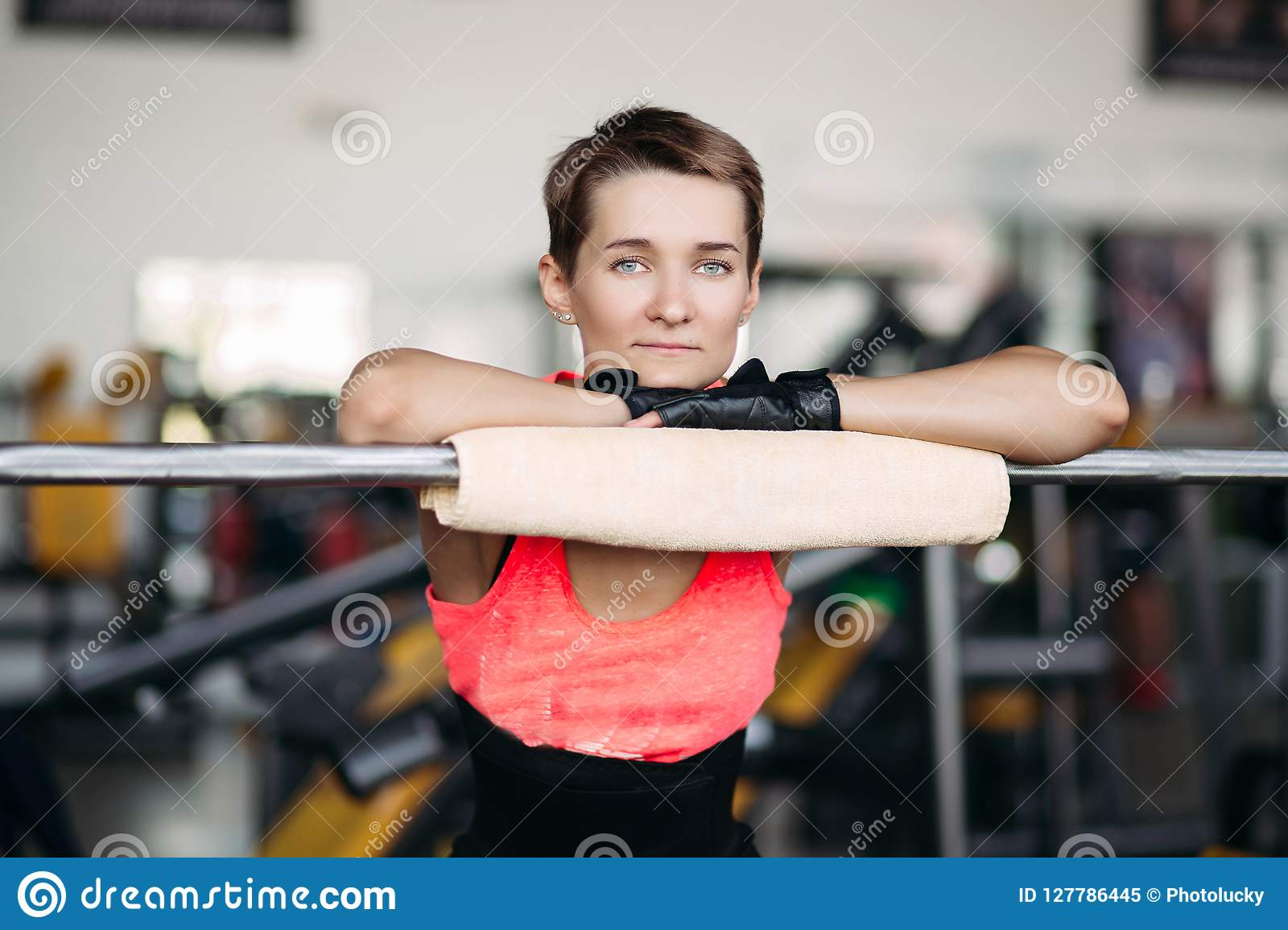 Woman With Short Hair In Pink Wear Resting In Gym After Workout With Barbell Stock Image Image Of Beautiful Health 127786445