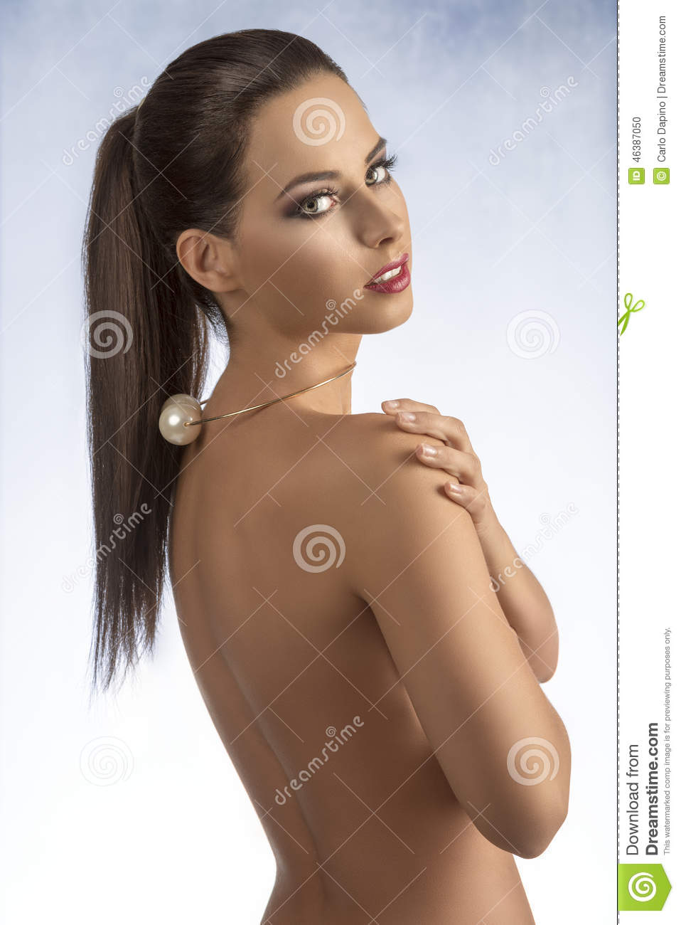 woman showing her nude back stock photo - image of accessory