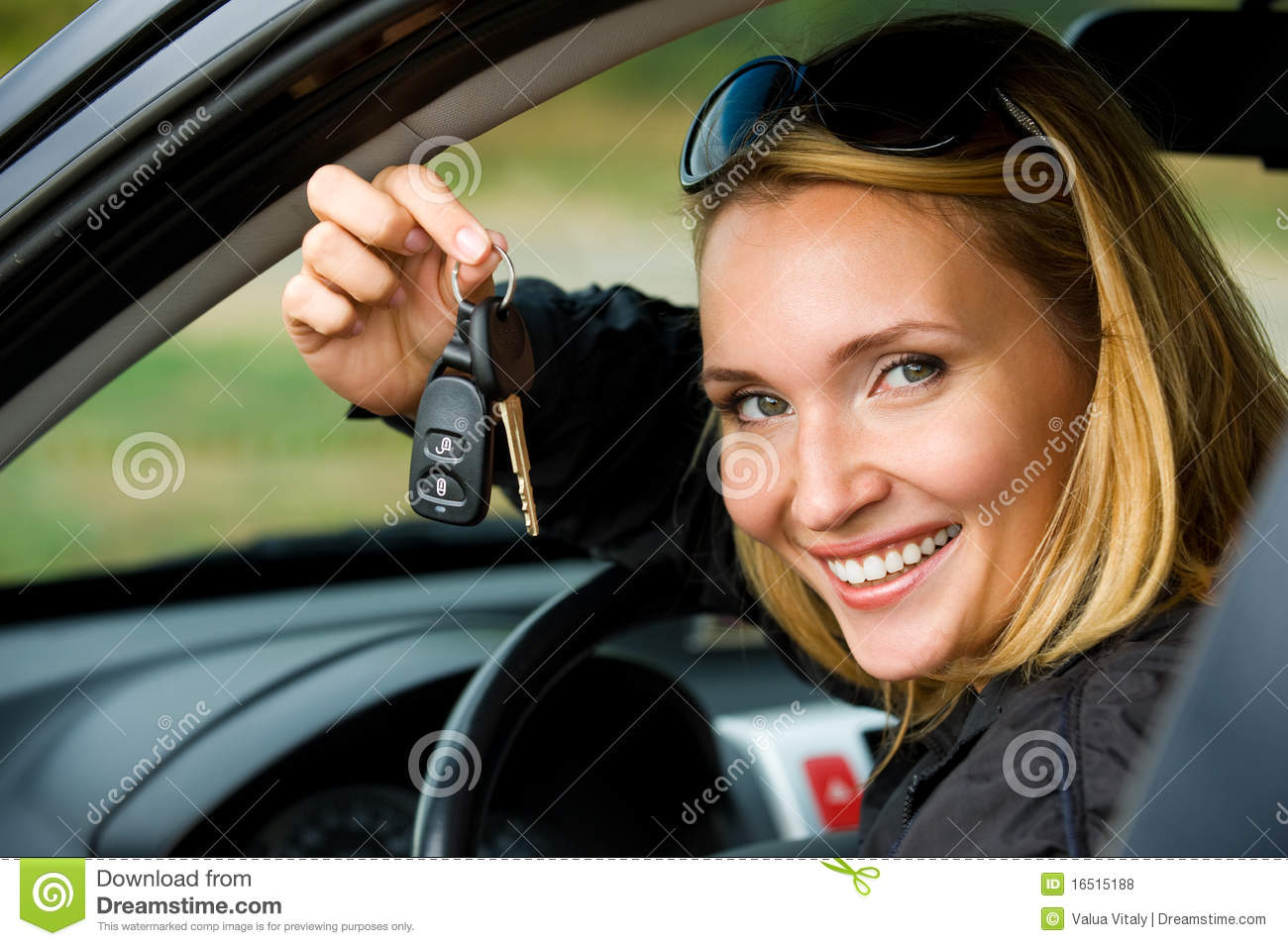 Woman shows keys from the car