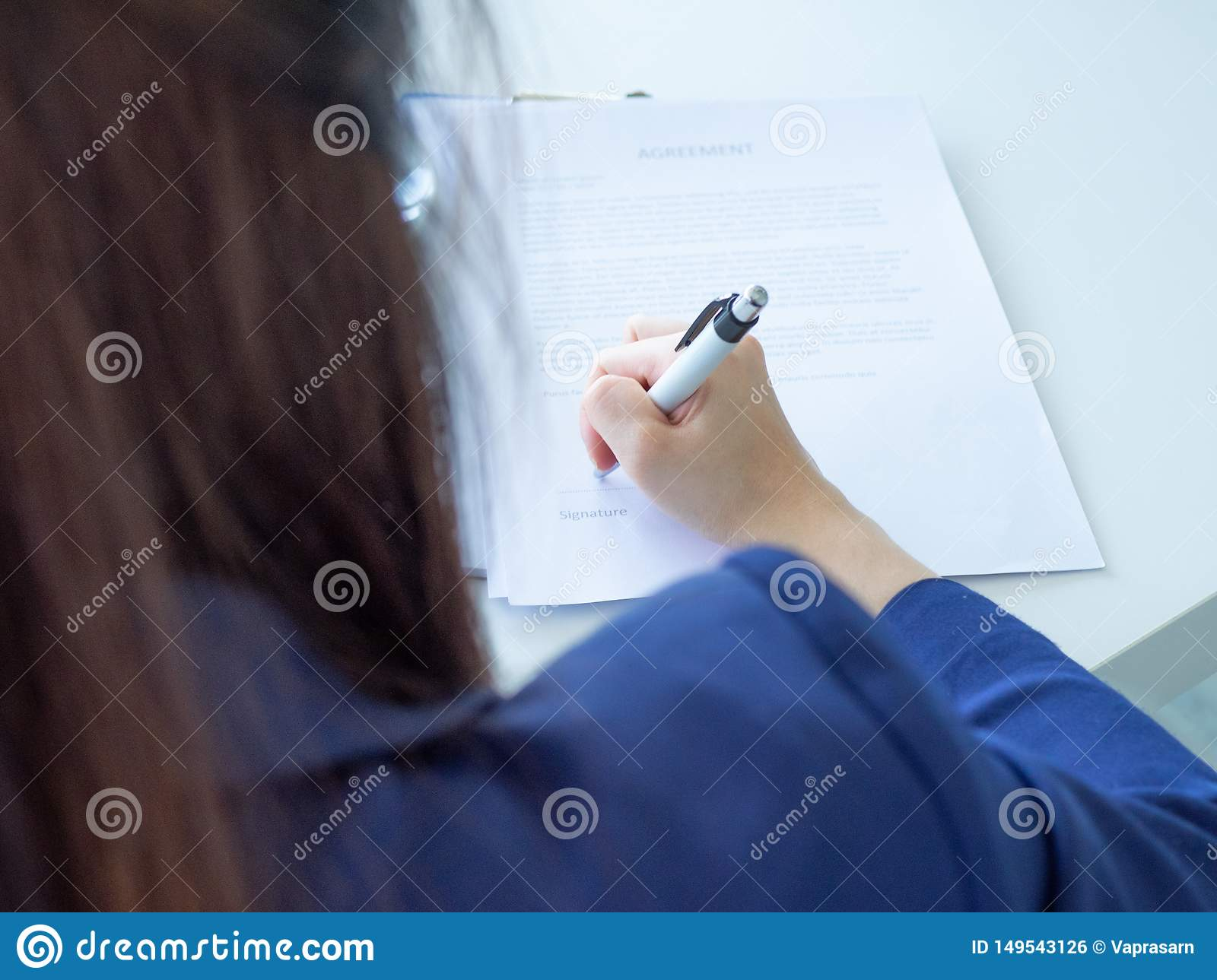 Woman sign contract