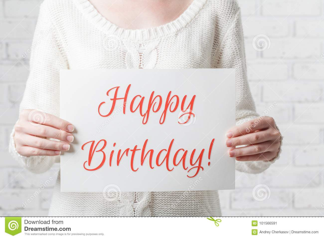 woman with a sign in her hands with the words happy birthday stock