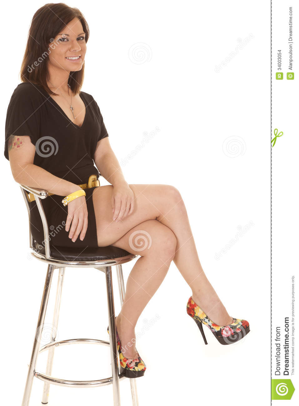 a woman is sitting in her A woman is sitting on the spinning seat of a piano stool with her arms folded what happens to her (a) angular velocity and (b) angular momentum when she extends her arms outward justify your answers.