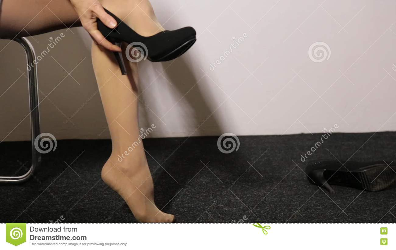 Woman Sits A Chair And Shakes Her Leg. Pose Showing Sexual Desire ...