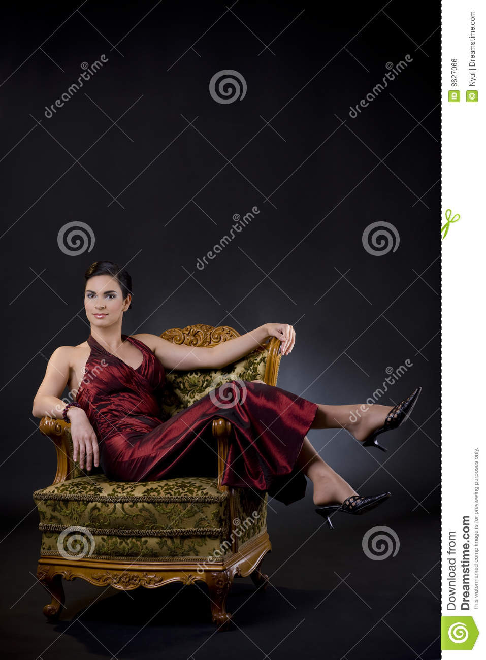 Woman sitting in arm chair royalty free stock image for Sitting in armchair