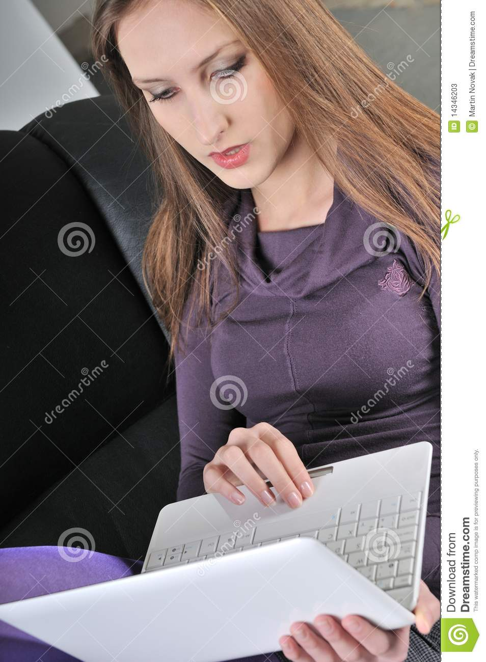 Woman sitting in armchair working stock photos image for Sitting in armchair