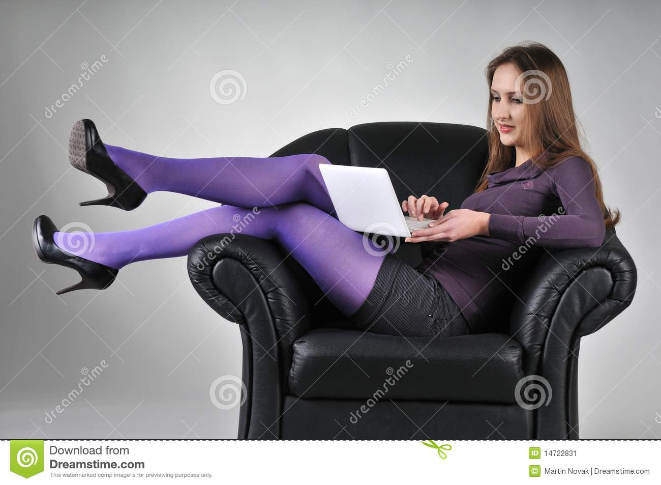 Woman sitting in armchair working stock image image for Sitting in armchair