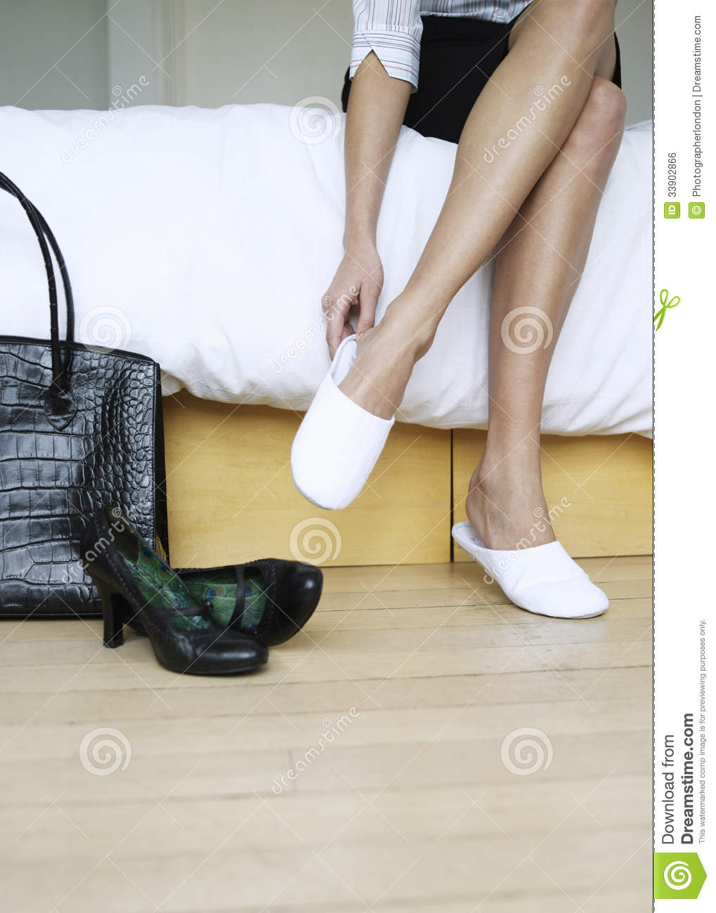 Woman Sitting On Bed Putting On Slippers Stock Photo Image Of Bedroom Female 33902866