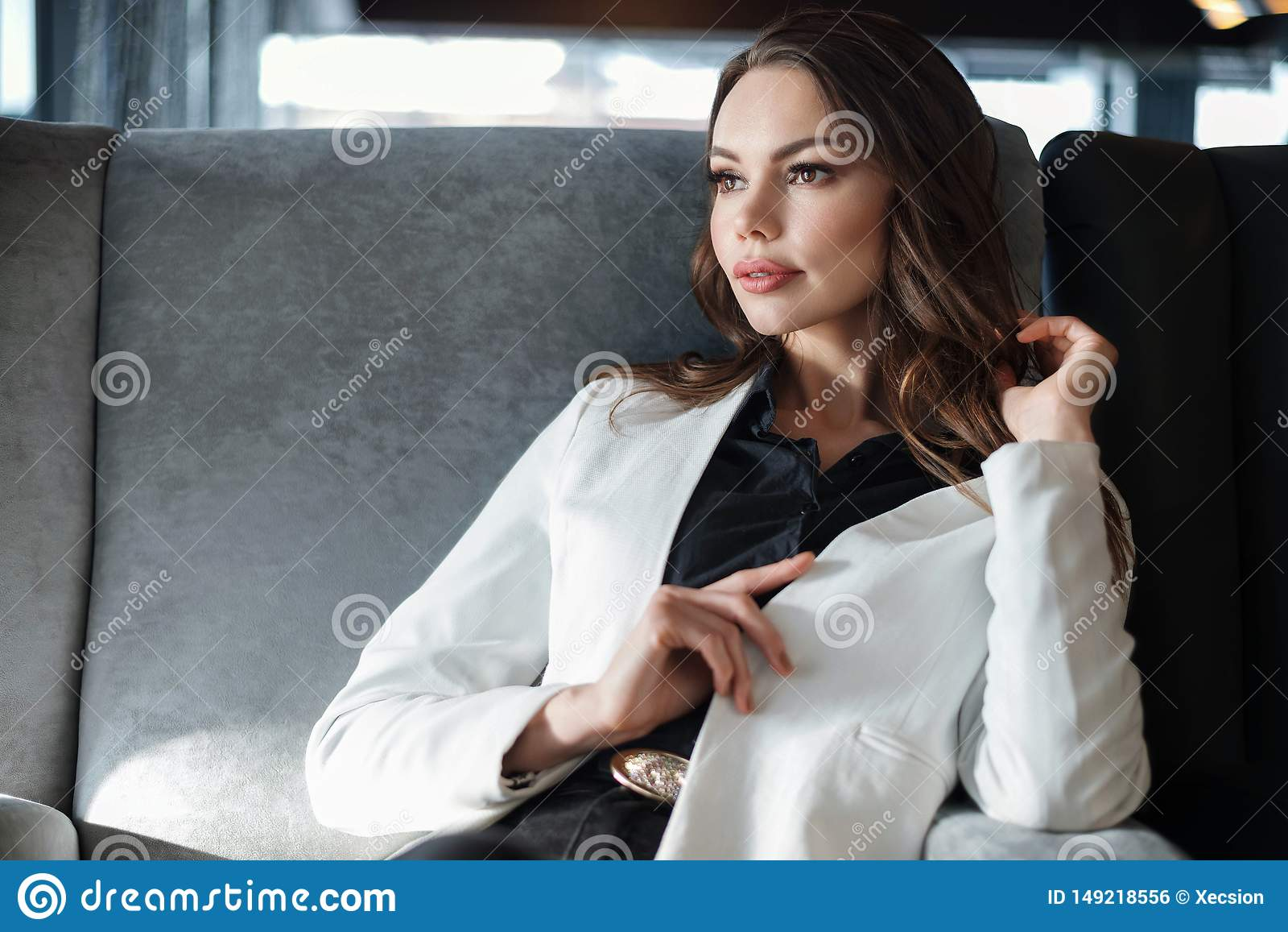 Woman sitting in a cafe. Close-up on a Cup of coffee in hand