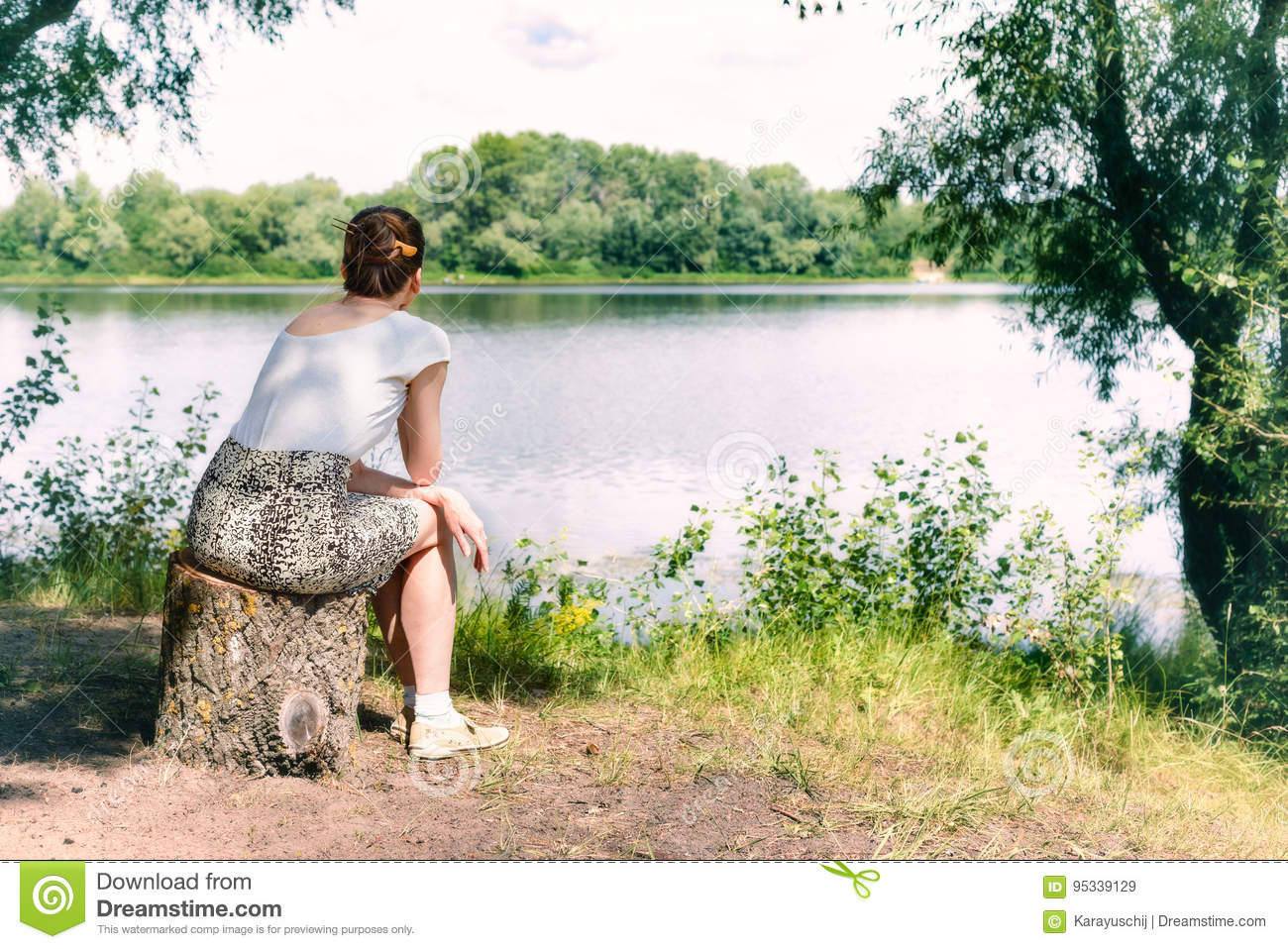 Woman Sitting Close to the River