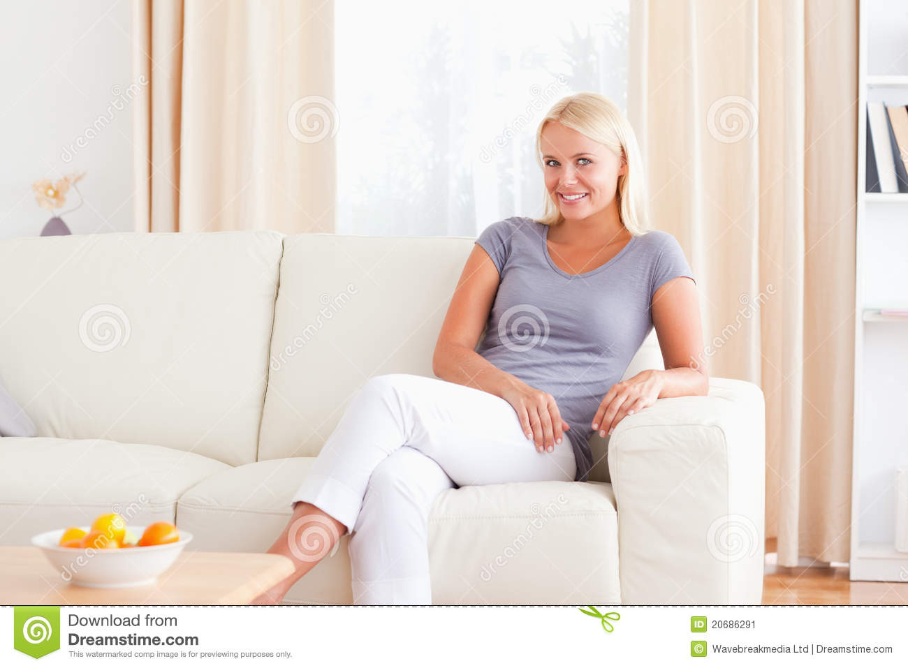 woman sitting on a couch stock image image of enjoy. Black Bedroom Furniture Sets. Home Design Ideas