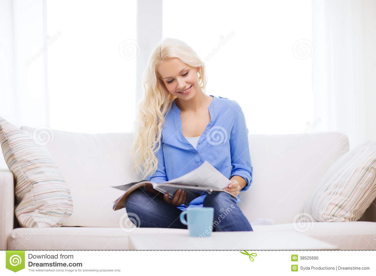 woman sitting on couch and reading magazine stock photo image 38525690. Black Bedroom Furniture Sets. Home Design Ideas