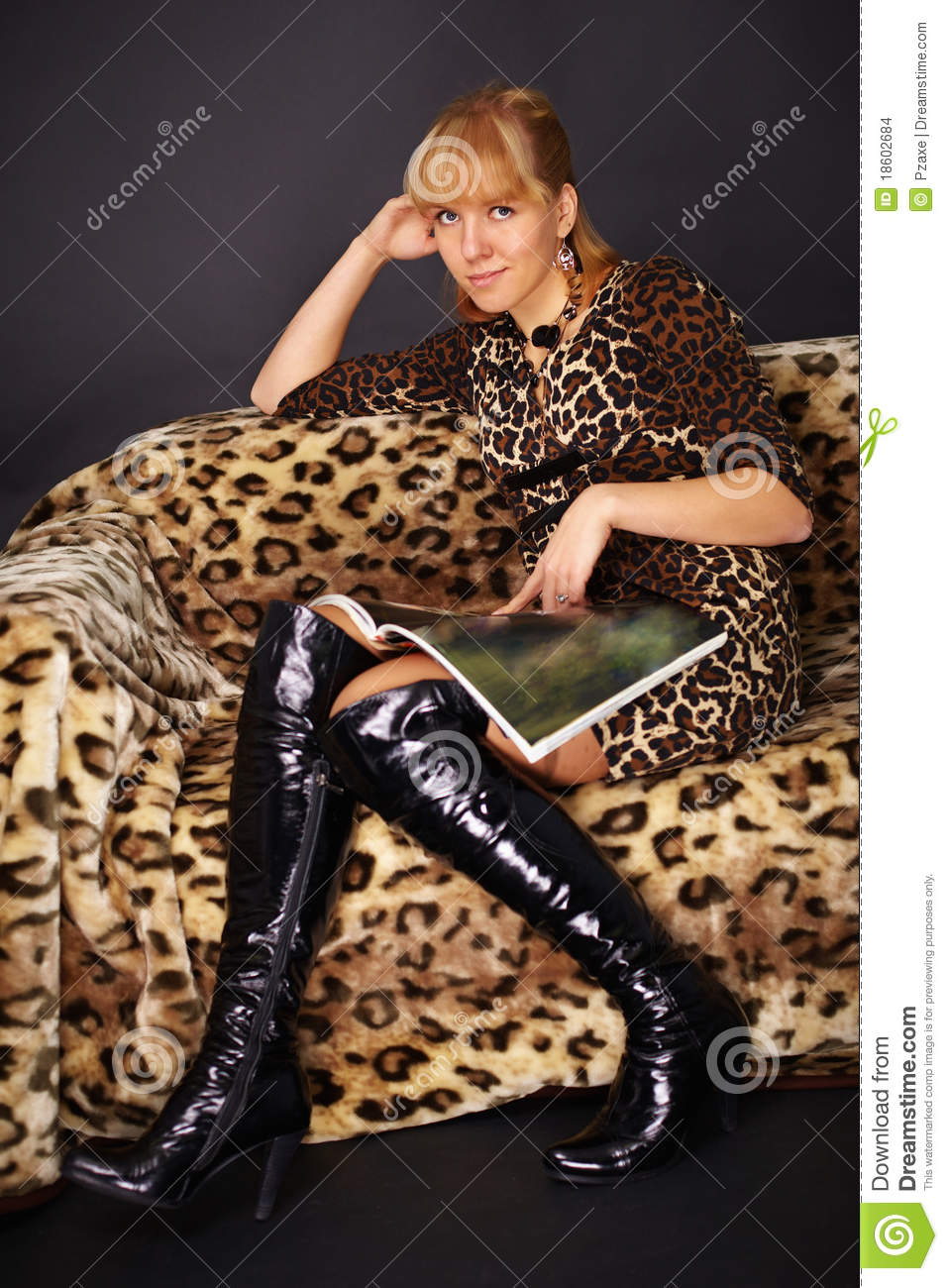 woman sitting on couch and reads fashion magazine stock images image 18602684. Black Bedroom Furniture Sets. Home Design Ideas