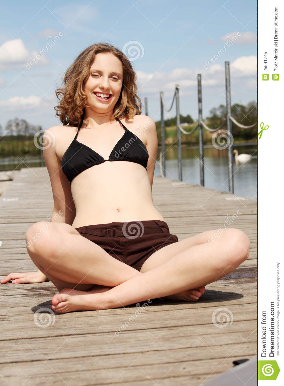 Woman Is Sitting With Crossed Legs On The Bridge. Stock ...