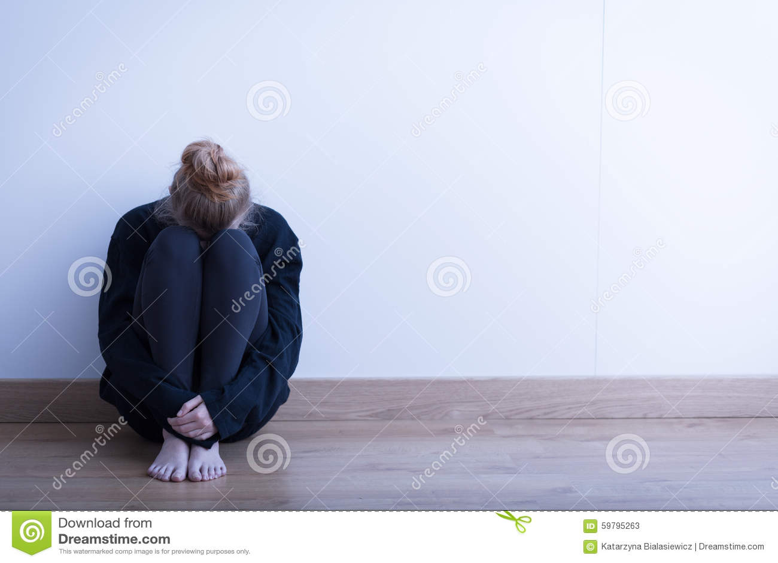 Z Antidepressant Woman Sitting Curled U...