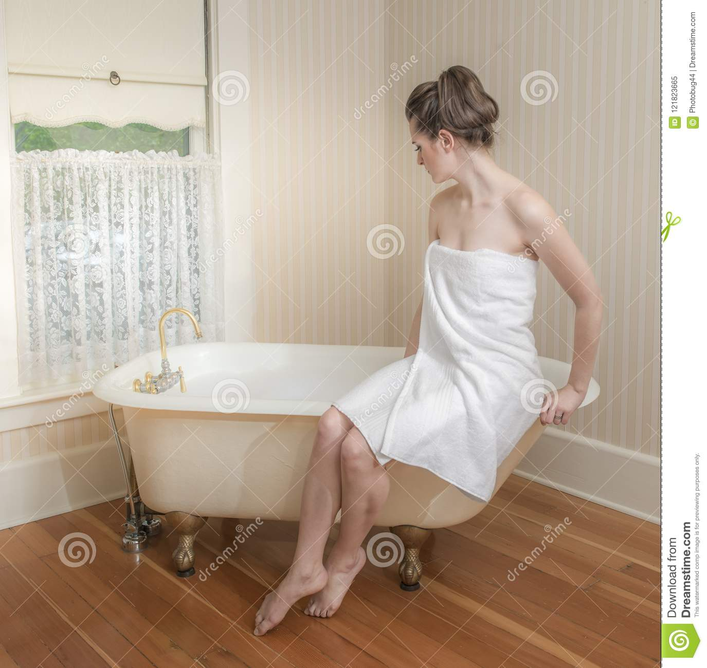 Young Naked Woman Sitting In Bathtub Translucent Cloth