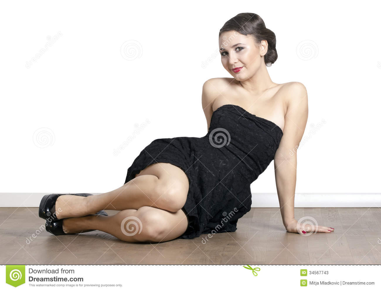 Woman Sitting On The Floor Stock Photos - Image: 34567743