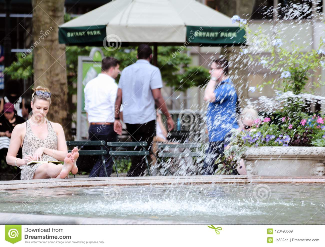 Young Woman Sitting Barefoot by a Fountain, Bryant Park, New York City