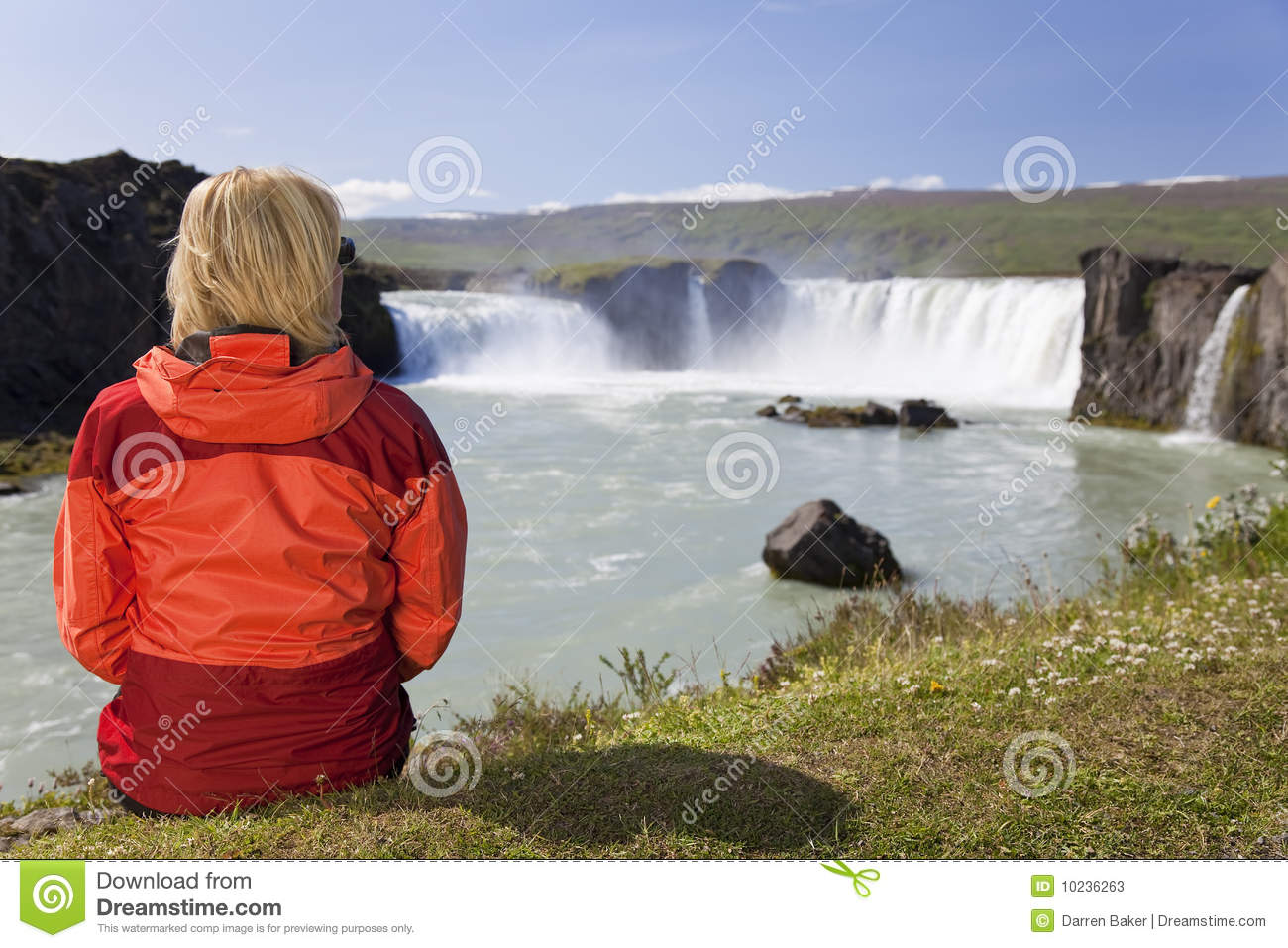 Woman Sitting on Rock While Staring on Waterfall · Free