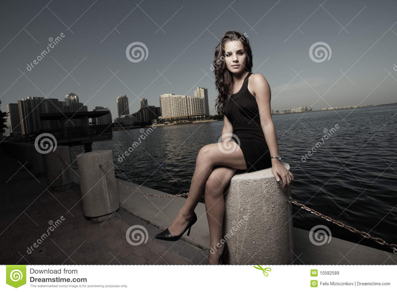 woman sitting with her legs crossed royalty free stock