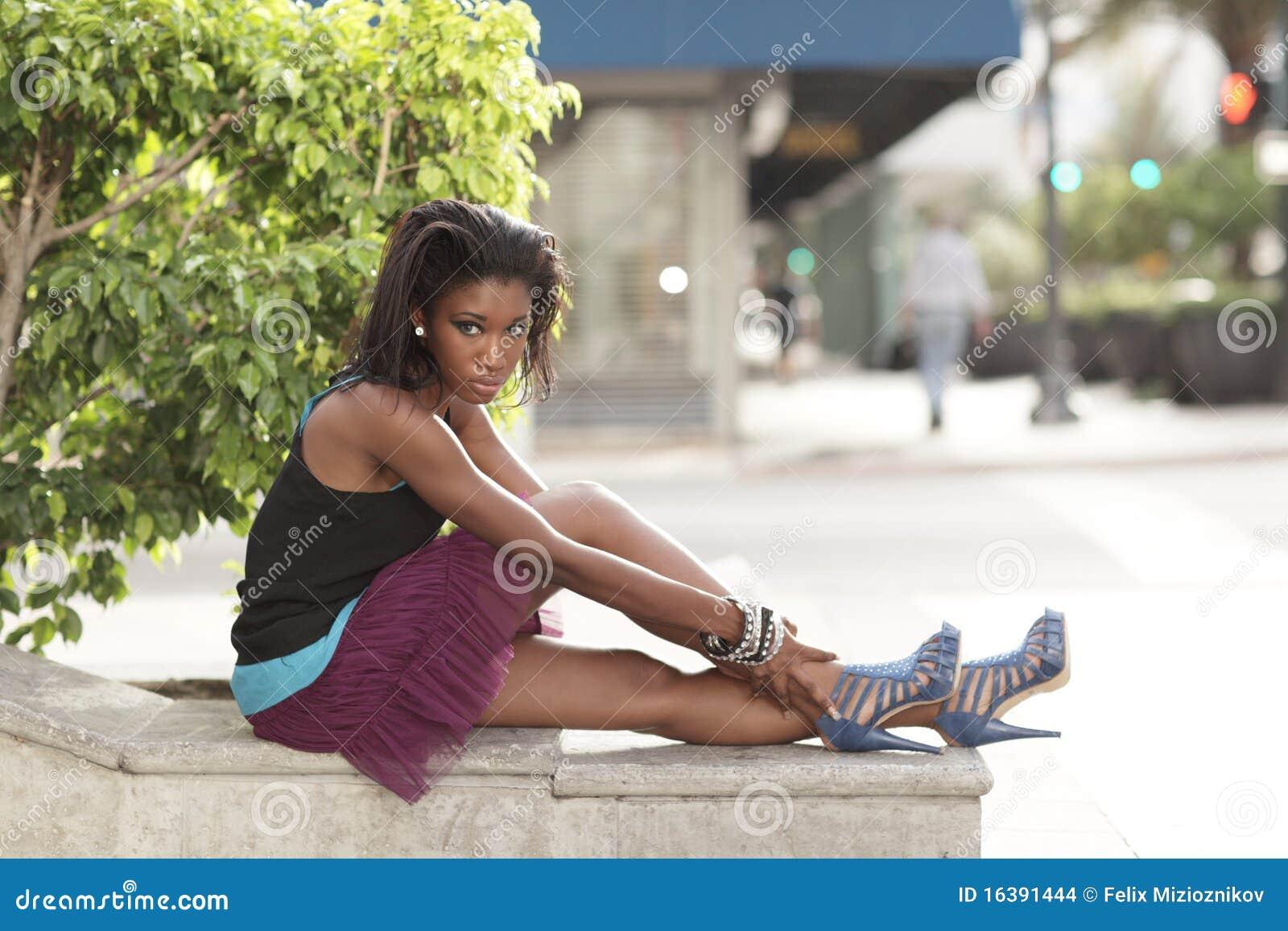 Woman Sitting On The Ledge Stock Images Image 16391444