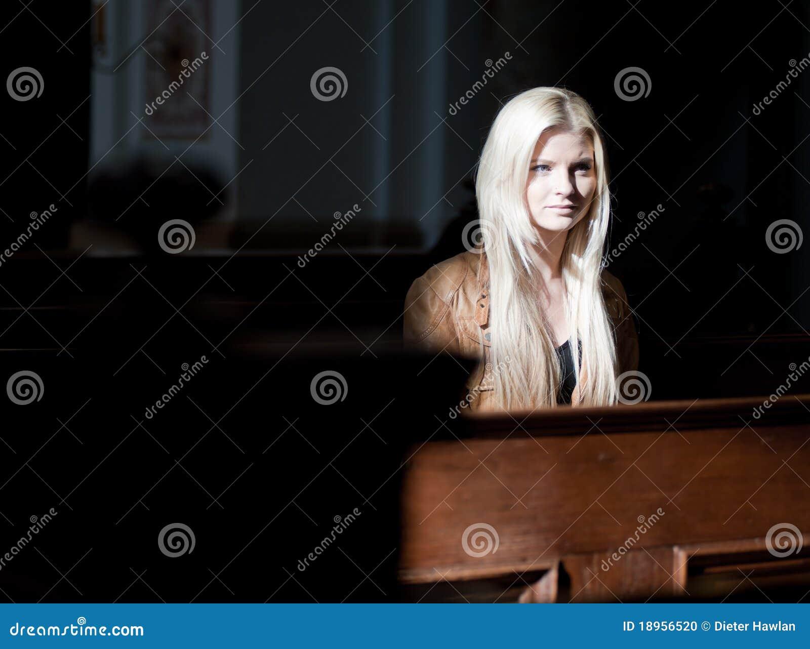Woman sitting on a Pew