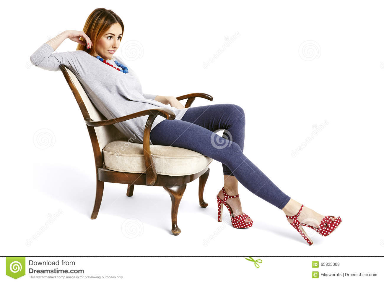 Portrait of attractive girl relaxing in armchair stock for Sitting in armchair