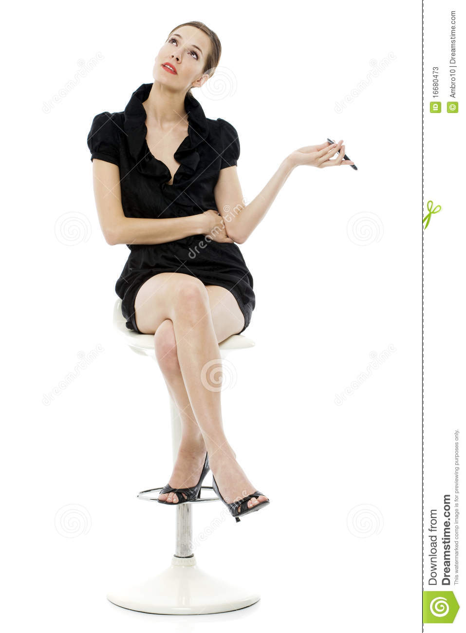Woman Sitting On A Stool Holding A Cellphon Stock Photos