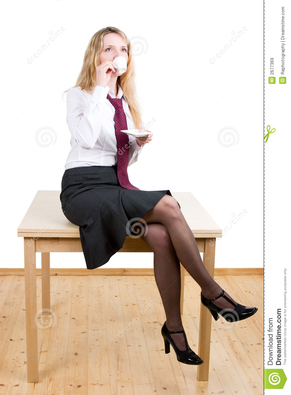 Woman Sitting On A Table Royalty Free Stock Images - Image: 2677369